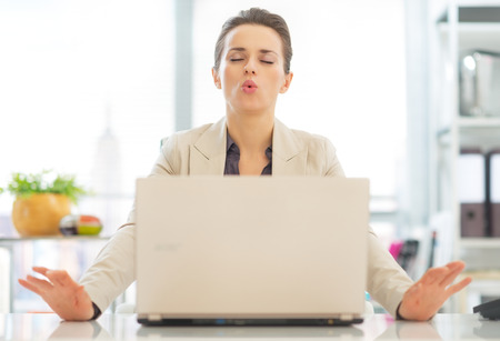 28131477 - business woman with laptop relaxing